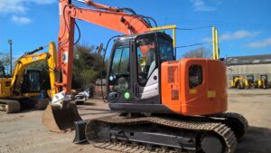2014 Hitachi ZX135US-5B,Blade,Hydraulic twin lock Quick hitch,Piped for hammer,Boom & Dipper C/V's,A/C,Rear view camera,Heated seat,Good Steel tracks,4790 Hours Image